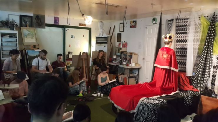 Artists participate in the 'Jankura's Rhapsody' Queen-themed figure-drawing session at Jankura Artspace on July 6 in Seoul. / Courtesy of Jankura Artspace