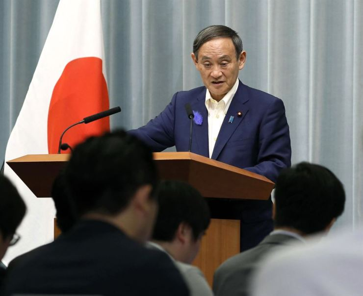 Japan's Chief Cabinet Secretary Yoshihide Suga speaks during a press conference at the prime minister's official residence in Tokyo on July 9. Japan said it has no plans to retract its tightened control on high-tech exports to Korea, saying it involves Japanese internal policy review. Kyodo News via AP