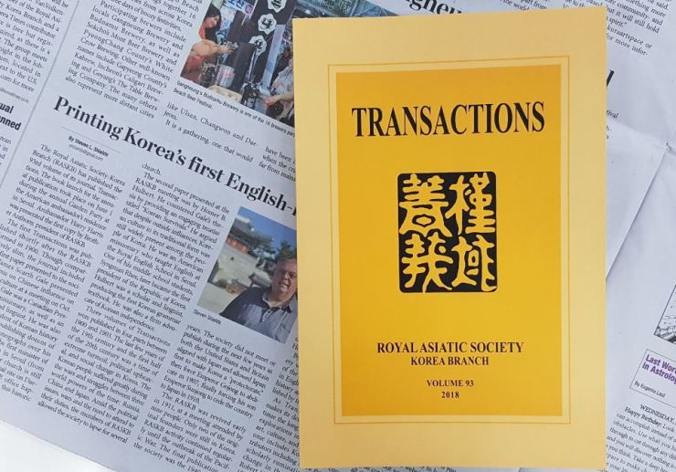 A copy of Transactions issue 93 / Korea Times photo by Jon Dunbar