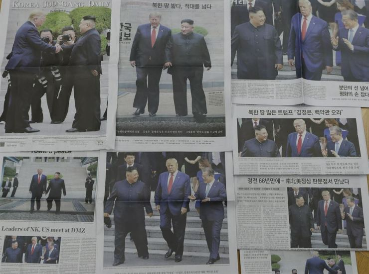 This image shows newspapers' front pages with the images of the meeting of U.S. President Donald Trump and North Korean leader Kim Jong Un, in Seoul, South Korea, Monday, July 1, 2019. North Korea's state media is describing leader Kim's meeting with President Trump at the Demilitarized Zone as 'an amazing event' in the border village it notes is a symbol of the Korean Peninsula's division. (AP Photo/Lee Jin-man)