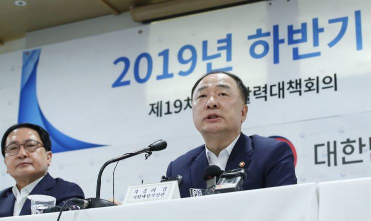 Minister of Economy and Finance Hong Nam-ki speaks during a briefing on the government's policies for the latter half of 2019, at the Export-Import Bank of Korea in Seoul, Wednesday. / Yonhap