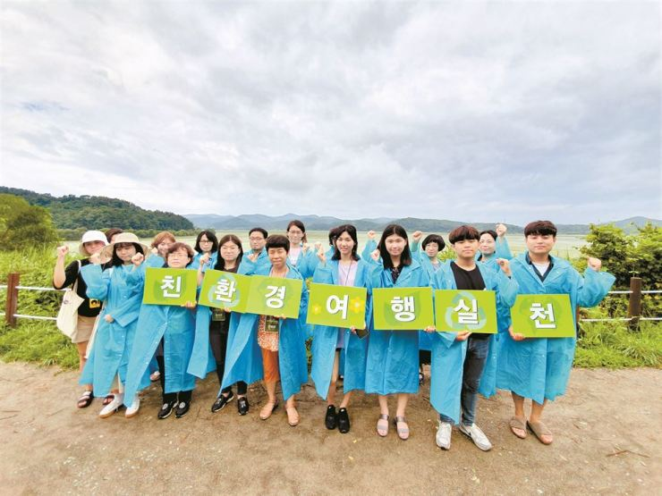 Participants of the Korea Tourism Organization's eco-friendly tour pose at Upo Wetland in Changnyeong County, South Gyeongsang Province, July 21. / Courtesy of Korea Tourism Organization