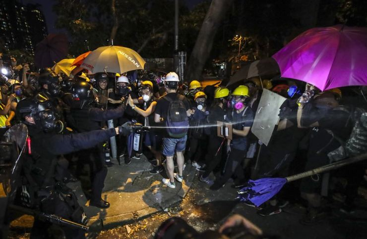 Anti-riot police clash with protesters during a mass rally in Yuen Long, New Territories, Hong Kong, July 27. EPA