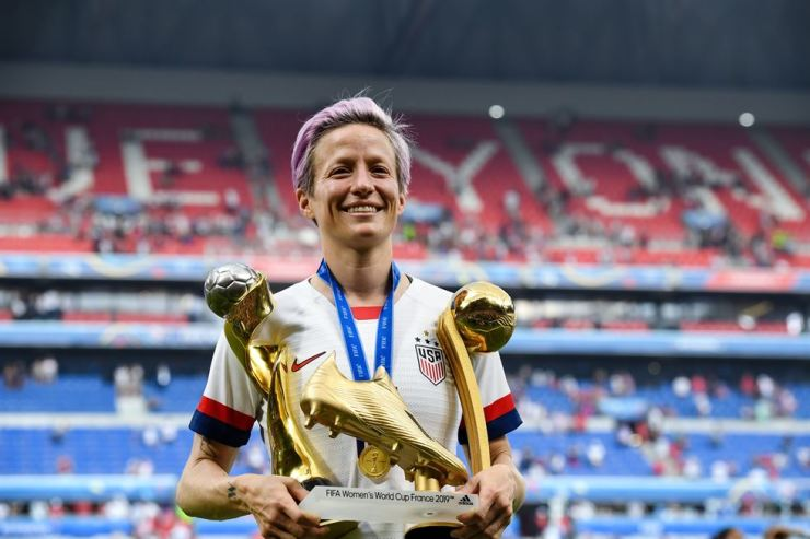 Megan Rapinoe of the United States poses with Golden Boot trohpy, Golden Ball trophy and World Cup championships trophy after the awarding ceremony of the 2019 FIFA Women's World Cup Final at Stade de Lyon in Lyon, France, July 7, 2019. Xinhua-Yonhap