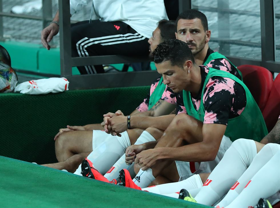 Juventus' Cristiano Ronaldo, center, sits on the bench before the kickoff of an exhibition match between K-League All Stars and the Italian football club at Seoul World Cup Stadium in the city's Mapo District, Saturday. /Yonhap
