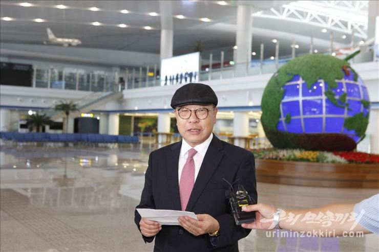 Choe In-guk speaks at an airport in Pyongyang, Saturday. Courtesy of Uriminzokkiri