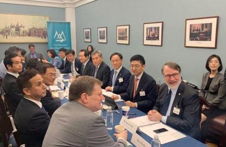 A delegation of South Korean lawmakers, on the right, attend a trilateral meeting with their counterparts from the U.S. and Japan in Washington to seek to boost cooperation and resolve a trade dispute between Seoul and Tokyo, July 27. Yonhap