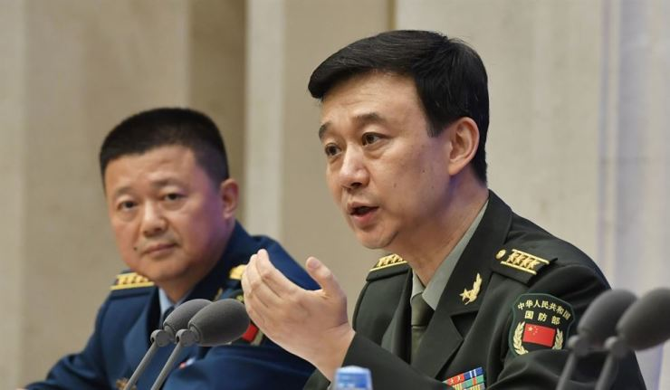 Chinese National Defence Ministry spokesman Wu Qian, right, at a news briefing in Beijing on July 24 after China released its defence white paper. Kyodo
