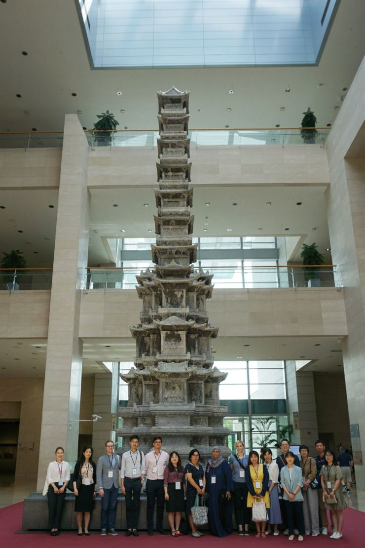 Participants of the 2019 Museum Network Fellowship Program pose for a photo in front of the 10-story Pagoda from Gyeongcheon Temple site on the first floor of the National Museum of Korea in Yongsan-gu, central Seoul. Courtesy of National Museum of Korea