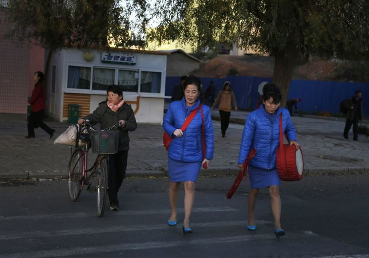 North Korean women cross a road in Pyongyang, Oct. 27, 2018. AP