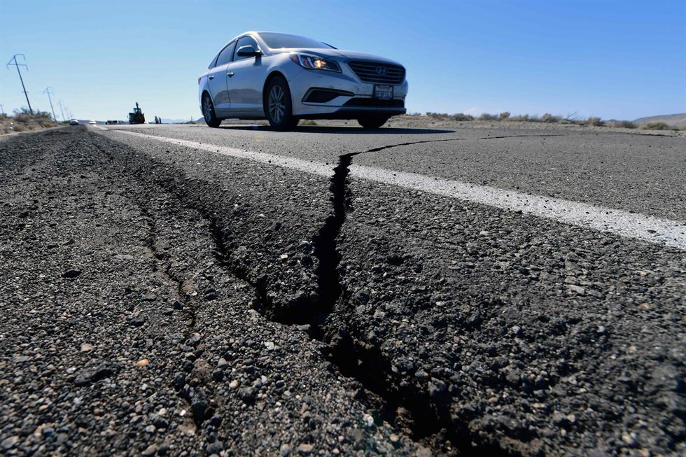 A road is damaged from an earthquake on July 4 in Trona, Calif. A strong earthquake rattled a large swath of Southern California and parts of Nevada, rattling nerves on the July 4th holiday and causing some damage in a town near the epicenter, followed by a swarm of aftershocks. AP