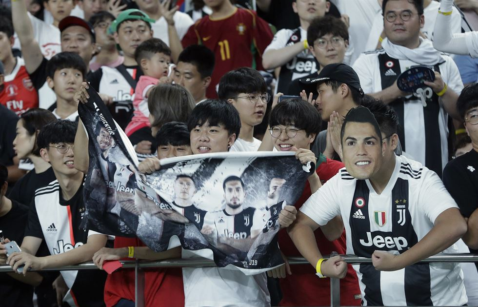 Cristiano Ronaldo, second from right, of Juventus sits on the bench prior to a friendly match against Team K League at the Seoul World Cup Stadium in Seoul, South Korea, Friday, July 26, 2019. AP-Yonhap