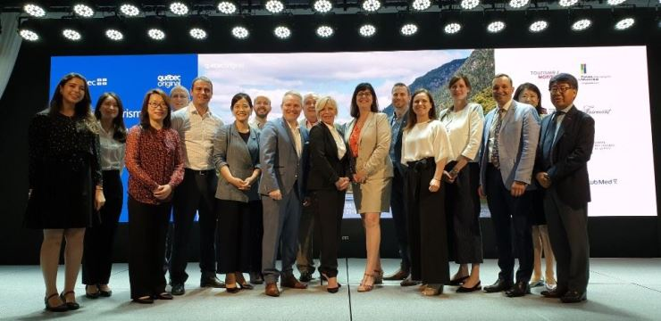 Quebec Tourism Minister Caroline Proulx, 10th from left, poses with other participants during a seminar to promote Quebec at the Novotel Ambassador Seoul Dongdaemun Hotels and Residences in Seoul, July 3. / Korea Times photo by Yi Whan-woo