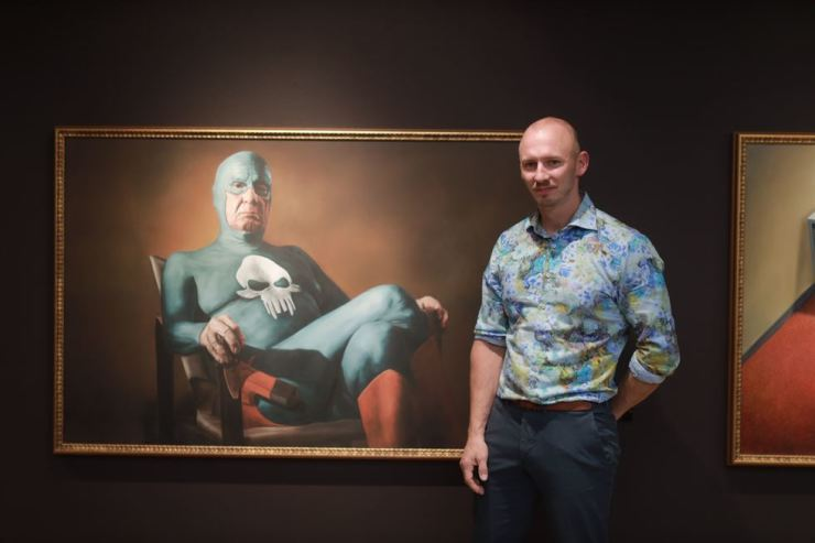 Andreas Englund poses for a photo in front of his works displayed at Lotte Gallery in northeastern Seoul. Courtesy of IADG