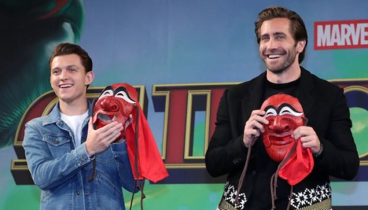 Tom Holland, left, and Jake Gyllenhaal hold traditional Korean masks decorated like Spider-Man's costume during a promotion for the latest Marvel movie 'Spider-Man: Far From Home' at a media conference held in Jongno-gu, central Seoul. Korea Times files