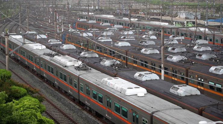 Subway trains sit idle at a rail yard in Busan, Wednesday, due to the union's indefinite strike after it failed to come to an agreement on wage issues with management. Yonhap