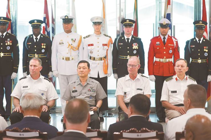 From left, U.S. Forces Korea Commander and chief of the U.N. Command (UNC) Gen. Robert Abrams; Maj. Gen. Kim Jong-moon, a senior member of the UNC Military Armistice Commission; Maj. Gen. Hibbe Corneliusson, a Swedish member of Neutral Nations Supervisory Commission; and Brigadier Huw Lloyd-Jones, a U.K. member of the UNC sending states, participate in a ceremony to commemorate the 66th anniversary of the Korean Armistice Agreement that ended the 1950-53 Korean War. The ceremony was held at Freedom House on the southern side of the Joint Security Area in the Demilitarized Zone, July 27. Abrams vowed continued support for the final and fully verifiable denuclearization of North Korea. Joint Press Corps
