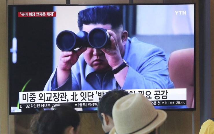 In this Aug. 2 file photo, people at Seoul Station stand by a TV screen showing footage of North Korean leader Kim Jong-un during a news program. North Korea on Tuesday continued to ramp up its weapons demonstrations by firing two short-range ballistic missiles into the sea while lashing out at the United States and South Korea for continuing their joint military exercises that the North says could derail fragile nuclear diplomacy. AP-Yonhap