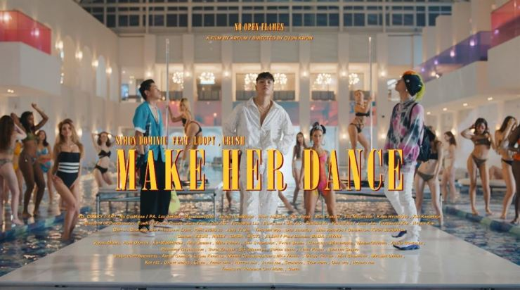 Korean rapper Simon Dominic, with Loopy and Crush, in a still from the 'Make Her Dance' teaser video. Capture from YouTube AOMGOFFICIAL