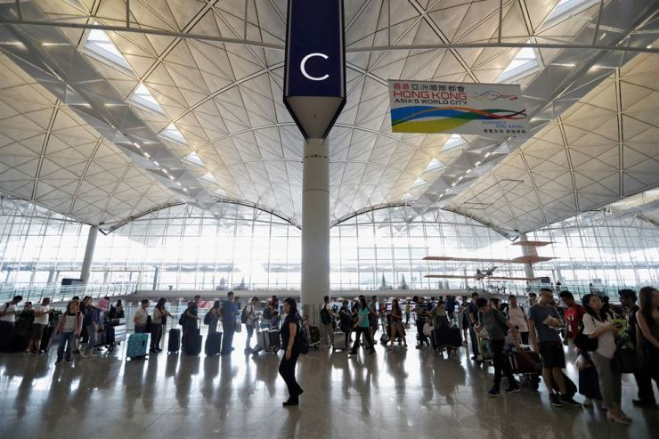 Passengers queue as the airport reopened a day after flights were halted due to a protest, at Hong Kong International Airport, China August 13, 2019. Reuters