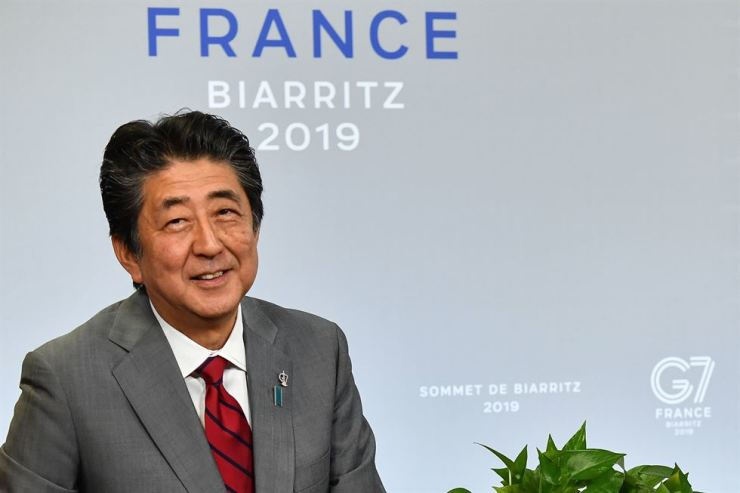 Japan's Prime Minister Shinzo Abe meets with the U.S. president (unseen) during a bilateral meeting on the sidelines of the G7 summit in Biarritz, southwestern France, Sunday, on the second day of the annual G7 Summit attended by the leaders of the world's seven richest democracies, Britain, Canada, France, Germany, Italy, Japan and the United States. AFP-Yonhap