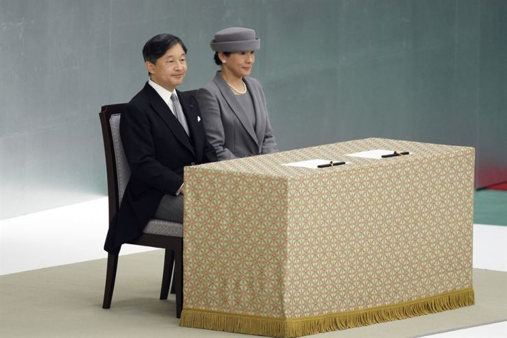 Japanese Emperor Naruhito, left, and Empress Masako, right, attend a memorial ceremony for the war dead at Nippon Budokan Martial Arts Hall in Tokyo, Thursday, Aug. 15, Emperor Naruhito expressed 'deep remorse' over Japan's role in World War II in his first appearance at the annual ceremony marking the end of the hostilities. AP-Yonhap