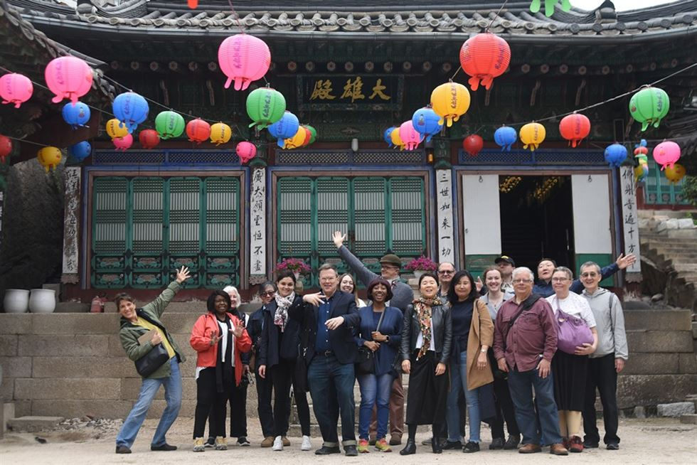 People sit in front of a stone entrance to Hwanggungu during a recent Royal Asiatic Society Korea Branch (RASKB) walking tour of Korean Empire sites. / Courtesy of RASKB