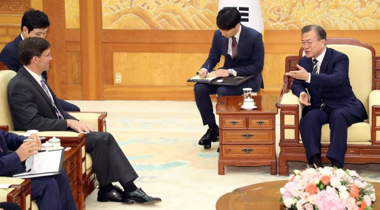 President Moon Jae-in speaks with U.S. Defense Secretary Mark Esper at Cheong Wa Dae, Friday. Yonhap