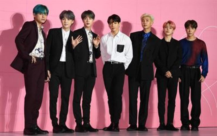 BTS is at a press conference in Seoul in this April photo. A local court ruled Sunday picking up a lost transportation card with a BTS photo is a crime because the owner is unlikely to have abandoned it and the special collection is regarded as property. / Korea Times file