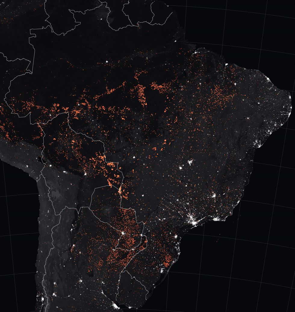 Handout aerial aerial picture released by Greenpeace showing fire raging in the forest in the municipality of Candeias do Jamari, close to Porto Velho in Rondonia State, in the Amazon basin in northwestern Brazil, on August 24, 2019. - Brazil on August 25 deployed two Hercules C-130 aircraft to douse fires devouring parts of the Amazon rainforest. The latest official figures show 79,513 forest fires have been recorded in the country this year, the highest number of any year since 2013. More than half of those are in the massive Amazon basin. Experts say increased land clearing during the months-long dry season to make way for crops or grazing has aggravated the problem this year. (Photo by Victor MORIYAMA / GREENPEACE / AFP)