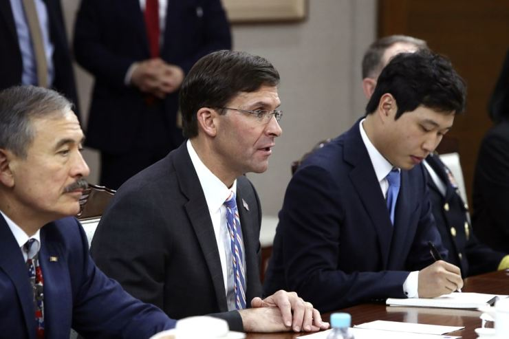 U.S. Defense Secretary Mark Esper, center, holds a meeting with South Korean Defense Minister Jeong Kyeong-doo, Aug. 9 in Seoul. AP-Yonhap