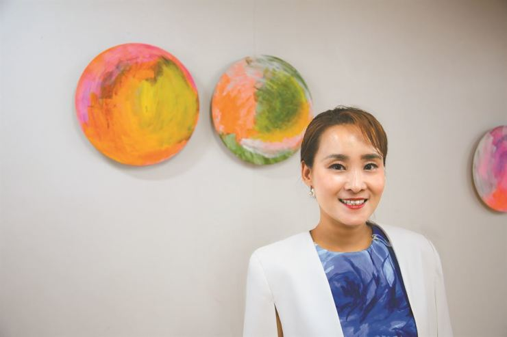 Artist Elly Cho with her works at her studio in central Seoul, Monday. Cho will present a video installation 'The Eclipse: Recognized by the Sound' during Art Asia 2019 at COEX from Thursday through Sunday. Korea Times photo by Kwon Mee-yoo