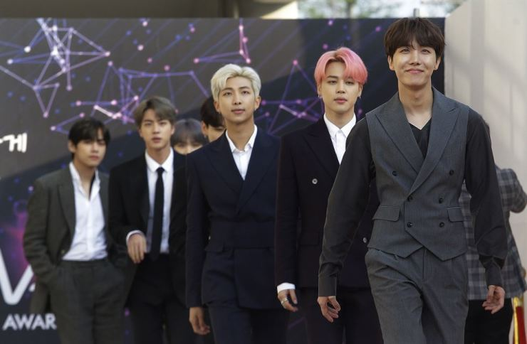 BTS members arrive for the Fact Music Awards in Incheon on April 24. They will take a break, the group's agency announced Monday. AP
