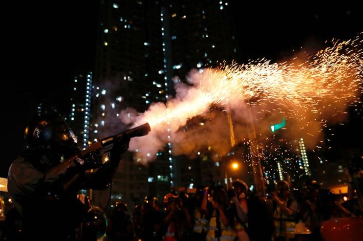 Riot police fire tear gas to disperse anti-extradition bill protesters after a march to demand democracy and political reforms, at Wong Tai Sin, Hong Kong, Aug. 24, 2019. Reuters