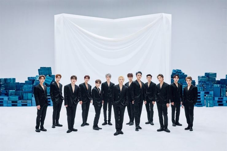 The 13-member boy band SEVENTEEN poses for its latest single 'HIT,' which was released Tuesday. The track topped the Worldwide ITunes Song Chart. /Courtesy of PLEDIS Entertainment