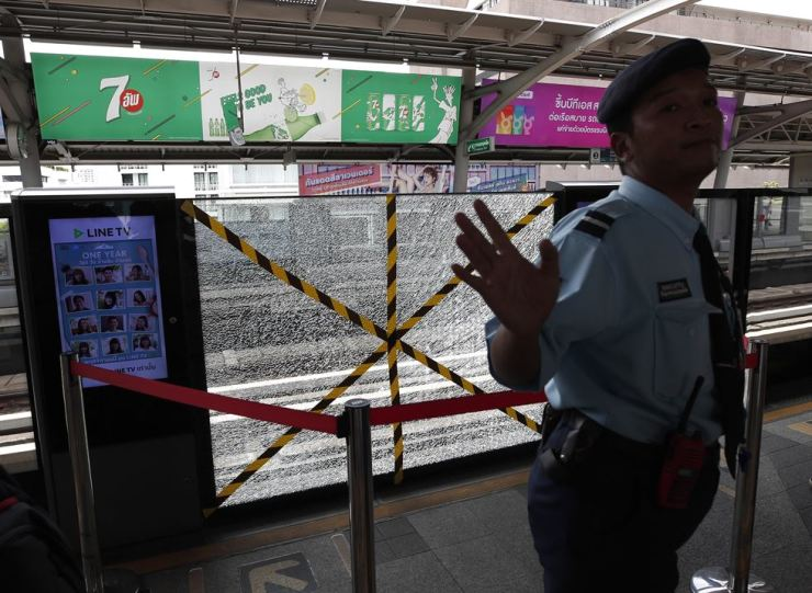 Traces of broken glass are visible on the Skytrain station next the area where a small bomb exploded in Bangkok, Thailand, Aug. 2. At least three bomb explosions were reported in Bangkok during morning peak hours. EPA