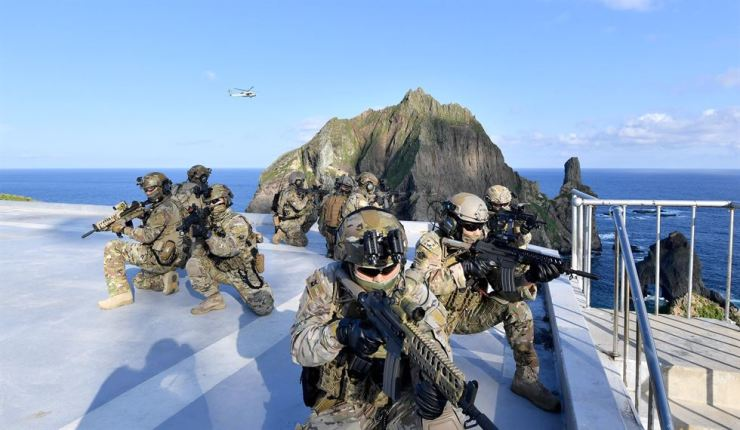 In this photo provided by South Korea's Navy, members of South Korean Navy's special forces participate during the drill on the islets called Dokdo in Korean and Takeshima in Japanese, Sunday, Aug. 25, 2019. AP-Yonhap