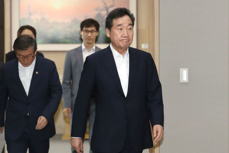 Prime Minister Lee Nak-yon walks into a room to preside over a Cabinet meeting at the Government Complex Sejong, Tuesday. Yonhap