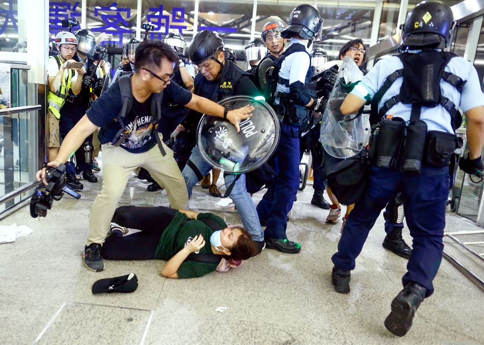 Hong Kong pro-democracy protesters, bottom, block access to the departure gates during another demonstration at Hong Kong's international airport on August 13, 2019. AFP-Yonhap