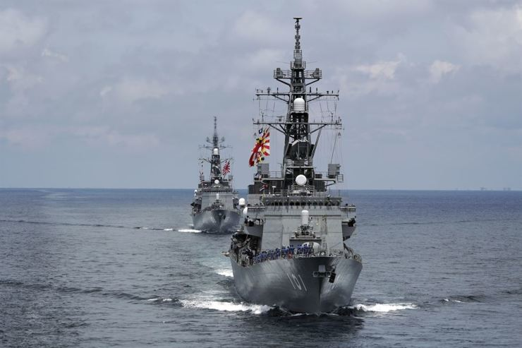 In this June 26, 2019, photo, Japan's Maritime Self-Defense Force (JMSDF) destroyers JS Murasame (DD-101), front, and JS Akebono (DD-108) participate in a drill off the coast of Brunei. AP-Yonhap