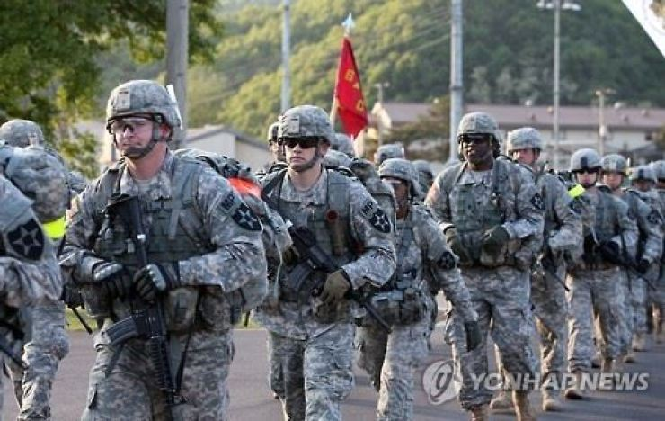 U.S. troops in Korea engage in an exercise. They have served as a key deterrent to North Korean invasions but their commander-in-chief, President Donald Trump, has attacked its relevancy. Yonhap