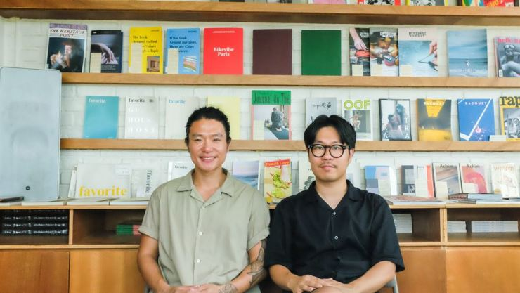 Co-publishers of 'favorite' magazine Kim Nam-woo, left, and Kim Jung-hyun pose for a photo at their shop/studio in central Seoul. Courtesy of Kim Jung-hyun, Kim Nam-woo