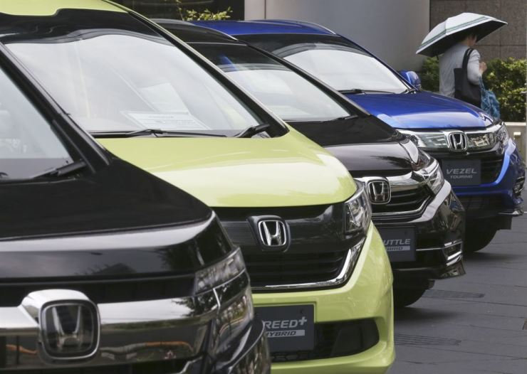 Honda cars on display at the automaker's headquarters in Tokyo, July 31. AP