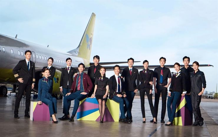 Jin Air flight attendants pose in the new line of uniforms that have been introduced on all their flights on July 1. The uniforms were designed by Lee Ju-young, inspired by Korean traditional crafts and reinterpreted to fit a modern design. Courtesy of Jin Air