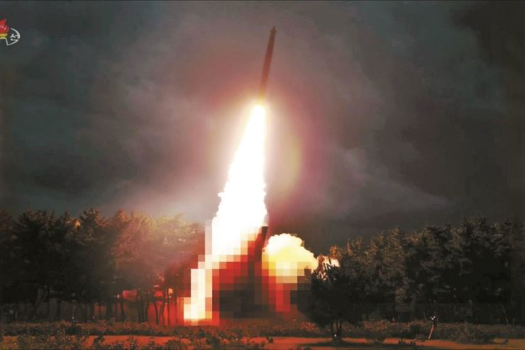 This video footage released by North Korea's state-run Korean Central Television (KCTV) on Thursday shows what North Korea has described as a test launch of 'newly developed large-caliber multiple launch guided rocket system' conducted the previous day. The KCTV intentionally pixelated the launcher. KCTV-Yonhap