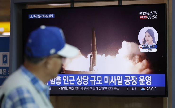 A man watches a TV news program reporting about North Korea's firing projectiles with a file image at the Seoul Railway Station in Seoul, South Korea, Saturday, Aug. 10, 2019. North Korea on Saturday extended a recent streak of weapons display by firing projectiles twice into the sea. AP