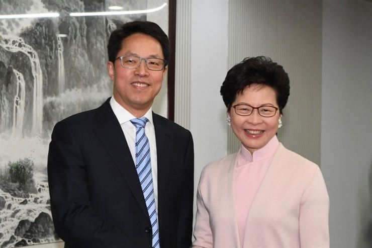 Hong Kong Chief Executive Carrie Lam, right, meets the director of the Hong Kong and Macau Affairs Office Zhang Xiaoming in Beijing last year. Photo from South China Morning Post