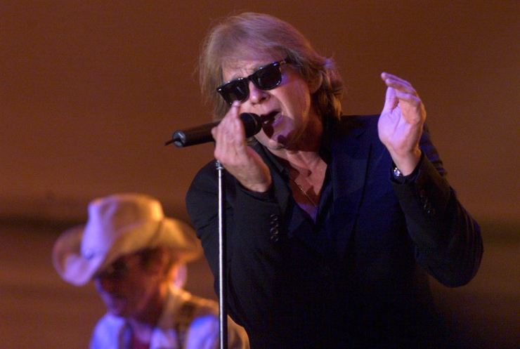 In this Aug. 6, 2004, file photo, Eddie Money performs during Grandstand Under the Stars at the Diamond Jo Casino in Dubuque, Iowa. AP