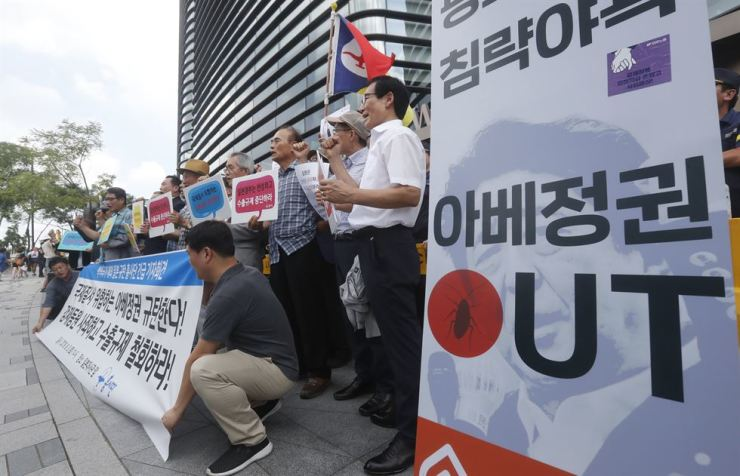 Protesters stage a rally to denounce Japan's new trade restrictions on South Korea in front of the Japanese embassy in Seoul, Aug. 3. AP-Yonhap