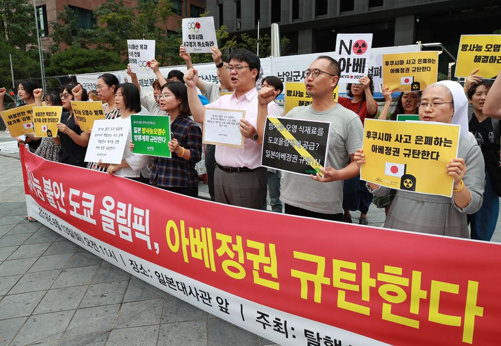 Environmentalists stage a rally in front of the Japanese Embassy in Seoul, Tuesday, to urge a boycott of the 2020 Tokyo Olympics. The Korean government said Monday it decided to remove Japan from a list of nations receiving preferential treatment in trade in what was seen as a tit-for-tat move following Tokyo's recent decision to downgrade Seoul's trade status amid a diplomatic row. AP